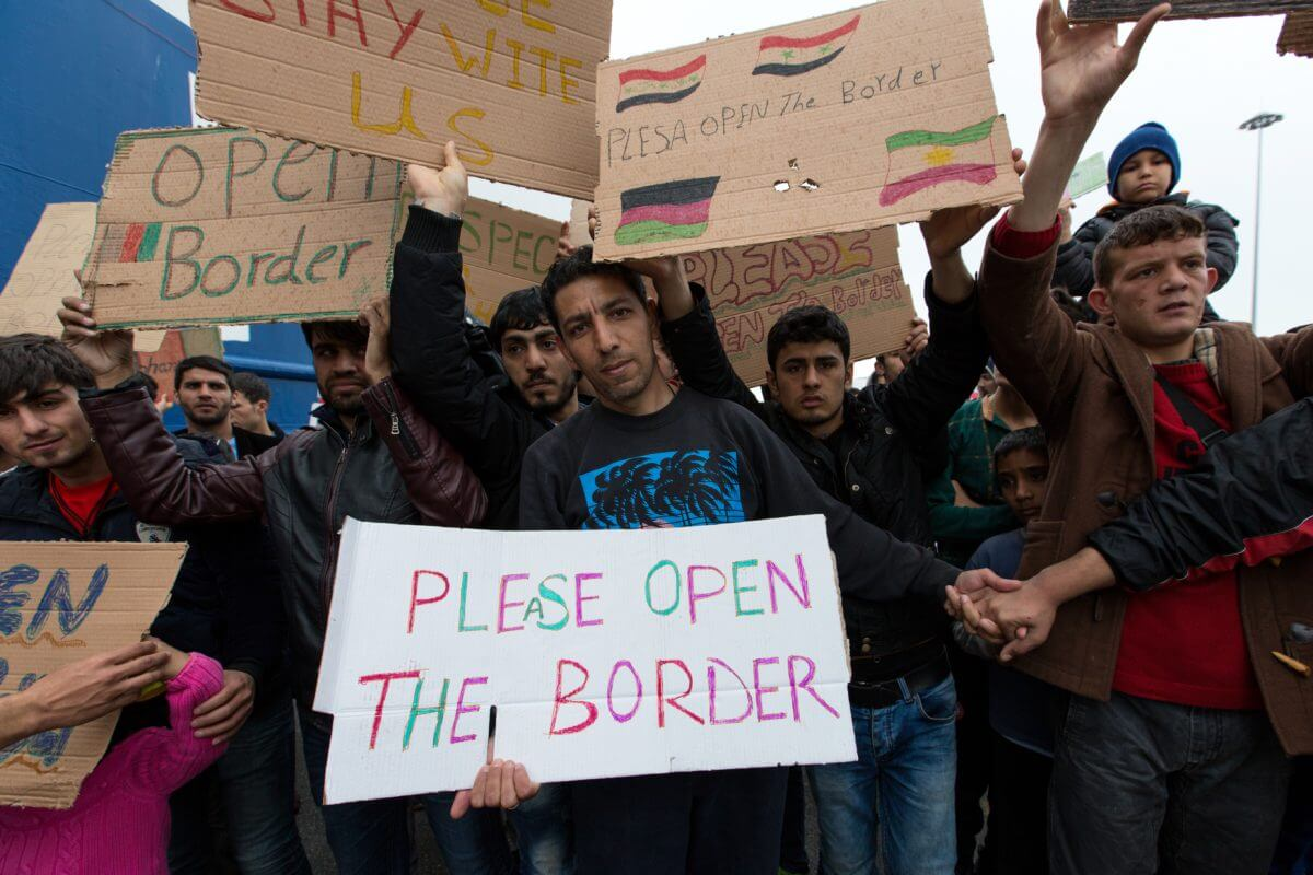 Desperate Afghans protest at Piraeus, Athens, fear deportation.