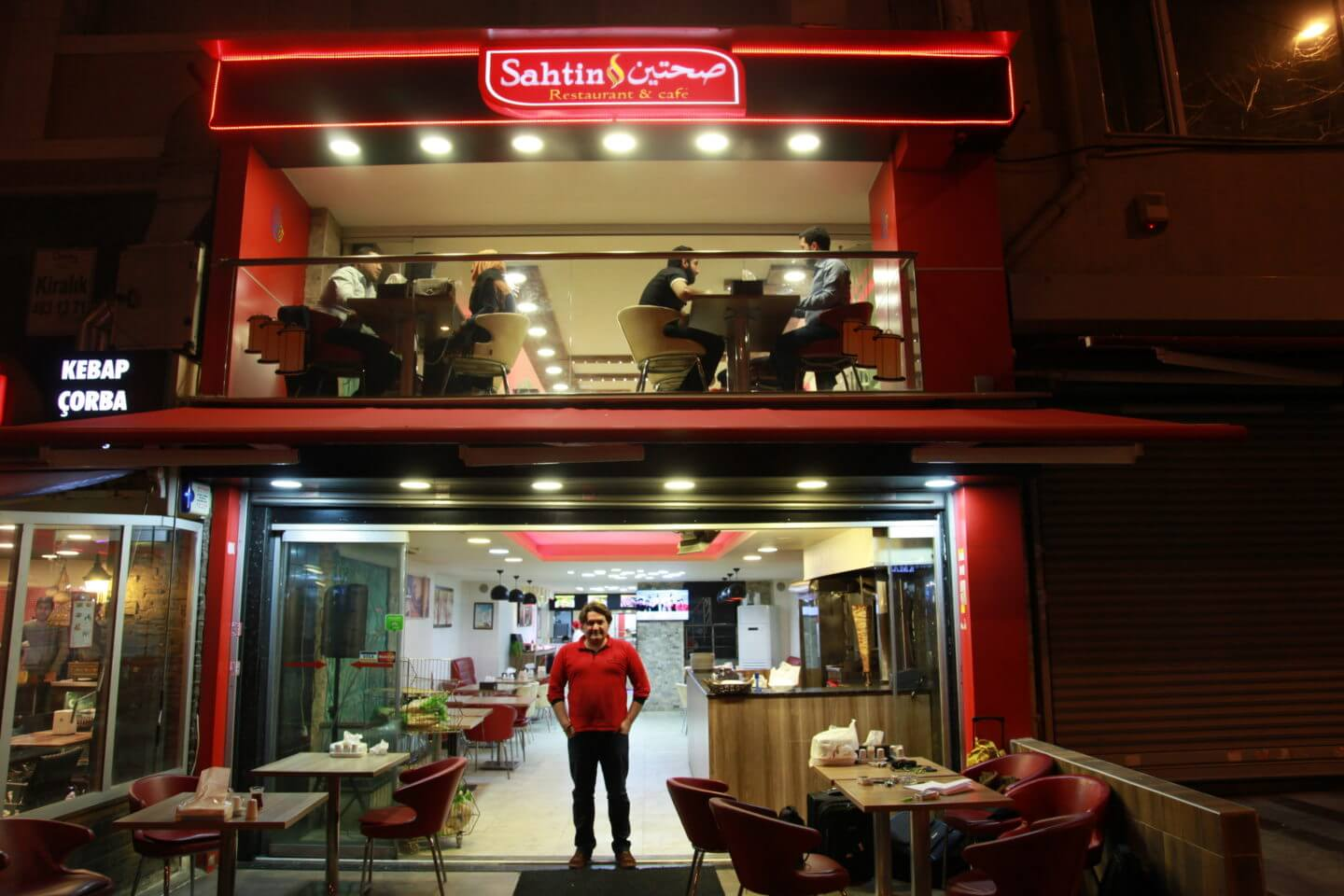 Samir Abboud in front of the restaurant he works in