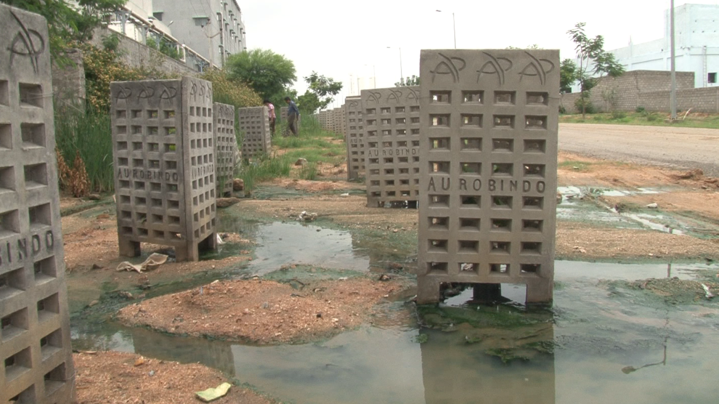 Green pools of effluent surrounding Aurobindo's Unit 7 in Polepally near Hyderabad where resistance to antibiotics was detected.