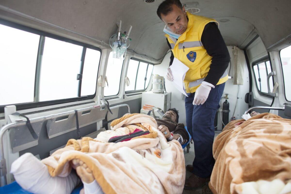 Kurdish medics and injured Mosul residents in ambulance