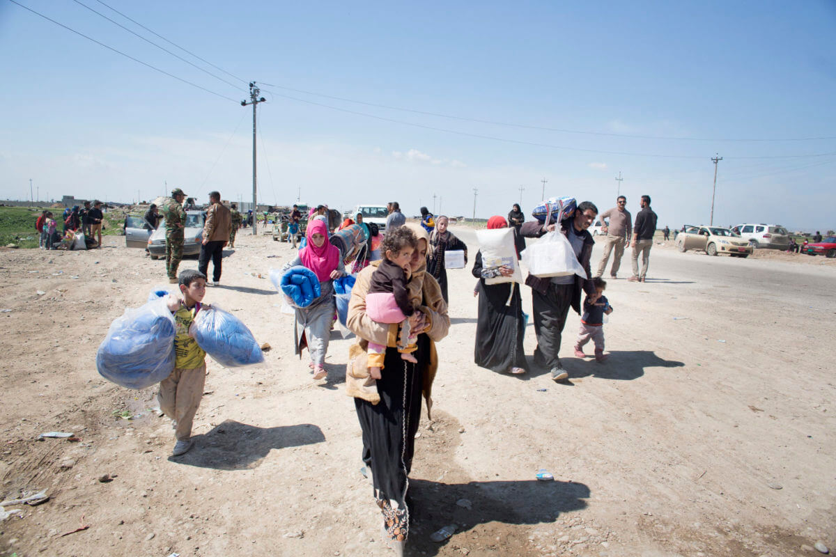 People from Mosul arrive at the Iraqi border where they board busses for camps in Iraqi Kurdistan.