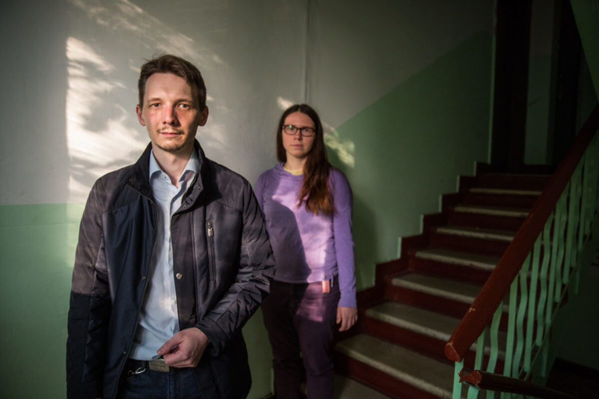 Nikolai Kanchov, who stood in recent municipal elections for the opposition party Yabloko, and resident Anastasia inside one of the condemned flats in the Metrogorodsky District.
