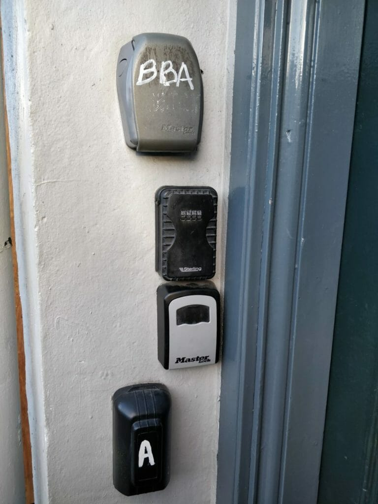 Key safes outside Edinburgh tenement door