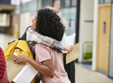 Students hugging after opening exam results